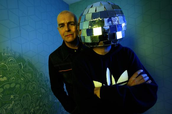 The Pet Shop Boys are Neil Tennant, left, and Chris Lowe, in a mirror ball helmet.
