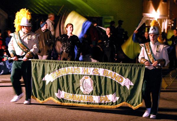 The Emmaus High School marching band carries the school banner during an Emmaus Halloween parade. Organizers of the parade are struggling to keep it going as both donations and volunteers have dropped over the past few years.