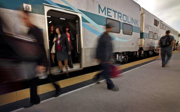 Incoming Metrolink passengers exit a train at Union Station in downtown Los Angeles.
