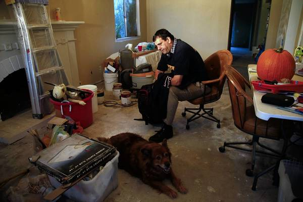 """I am barely squeaking by right now,"" says Timothy Maimone, a furloughed quality assurance specialist for the Department of Defense. Above, Maimone is in the living room of his Mission Viejo home, which is under renovation."