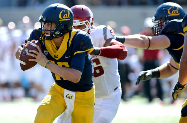 Cal quarterback Jared Goff tries to escape the pressure from Washington State's Emmitt Su'a-Kalio during their game last week.