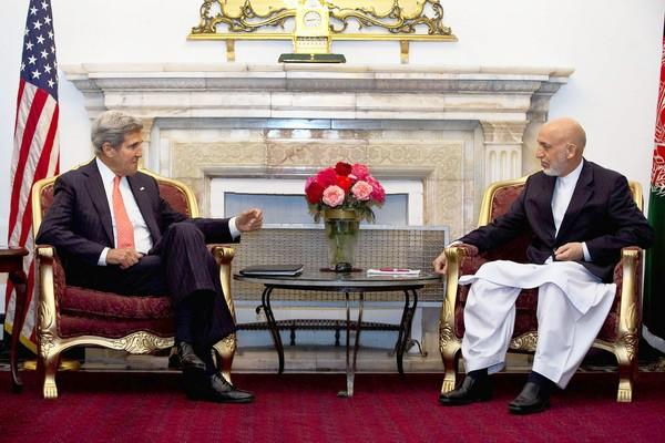 U.S. Secretary of State John F. Kerry meets with Afghan President Hamid Karzai at the Presidential Palace in Kabul on Friday. The two nations have until Oct. 31 to reach a security agreement.