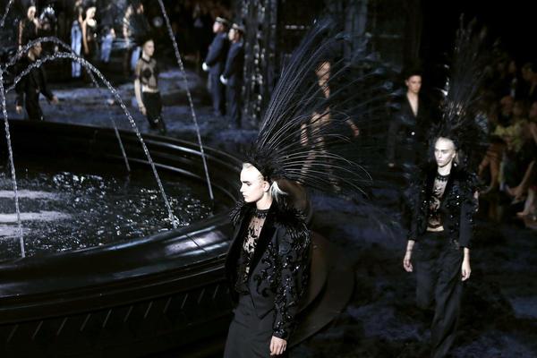 Models present creations for Louis Vuitton during spring/summer 2014 Paris Fashion Week.
