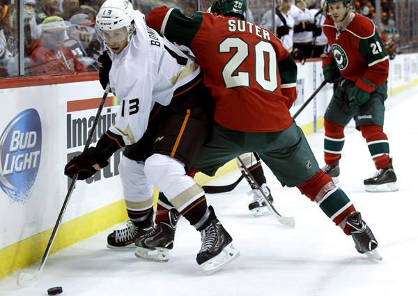 Ducks center Nick Bonino battles Wild defenseman Ryan Suter for the puck during a game earlier this season.