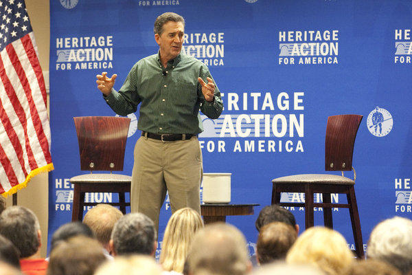 "The Heritage Foundation president and former Sen. Jim DeMint speaks to a town hall meeting held at the Crowne Plaza Tampa-Westshore in Tampa, Fla. on Aug. 21. ""There's no question in my mind that I have more influence now on public policy than I did as an individual senator,"" DeMint told NPR recently."