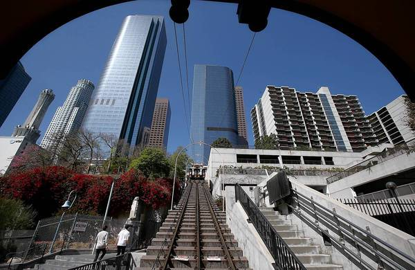 With Angels Flight closed again, downtowners must hoof it up and down the stairs between Hill and Olive streets. Months before a September derailment, operators of the historic funicular had been using a tree branch to hold down the start button and keep the trains running.