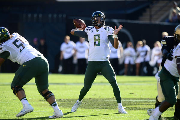 Oregon quarterback Marcus Mariota prepares to pass in the first quarter against Colorado.