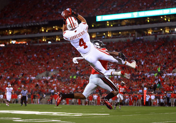 Badgers wide receiver Jared Abbrederis makes a jumping catch while being defended by a Ohio State defender during the first quarter.