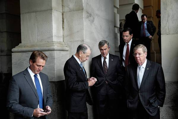 Republican Sens. Jeff Flake, left, Charles E. Grassley, Mike Johanns, John Barrasso and Johnny Isakson await a White House meeting on the budget impasse.