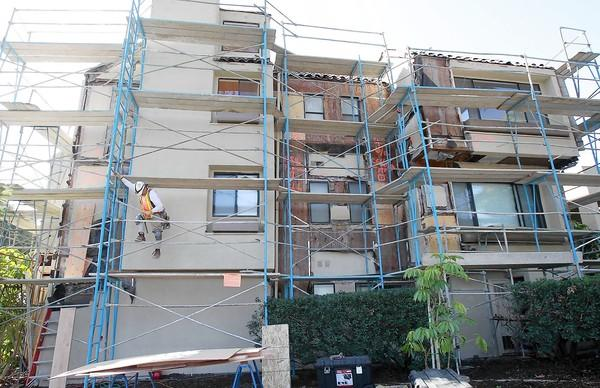 Residents of the Promontory Point apartments are upset with ongoing construction that they say creates too much dust, machinery noise, and unsafe scaffolding.