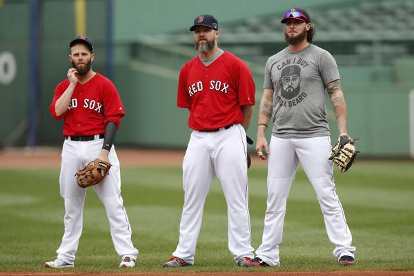 The Red Sox's Dustin Pedroia, David Ross and Jarrod Saltalamacchia during a team workout in preparation for the ALCS.