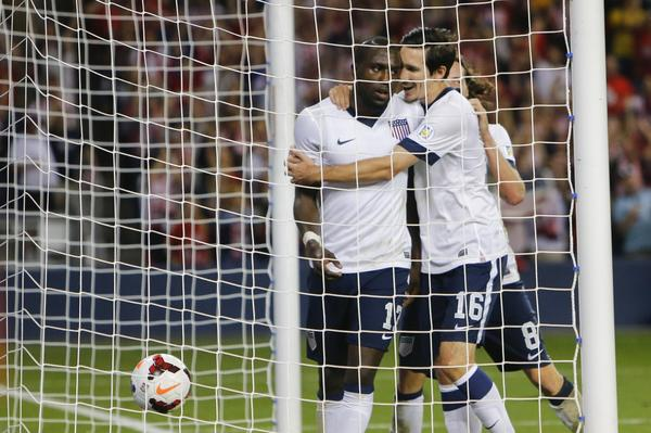 Sacha Kljestan and Mix Diskerud celebrate the second goal of the game scored by Jozy Altidore.