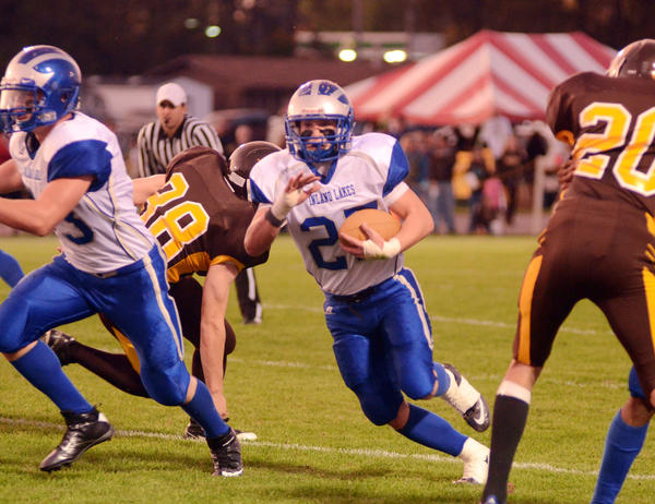 Inland Lakes running back Christian Wallace looks for running room during Friday's Ski Valley Conference North Division contest during homecoming at Pellston. The Bulldogs defeated the Hornets, 60-0.
