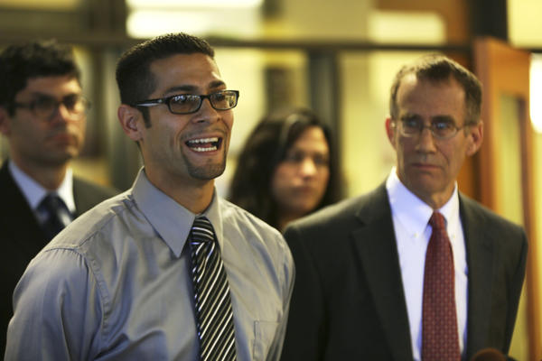 Juan Rivera, Jr. foreground left, speaks Tuesday, October 30, 2012 during a news conference at Northwestern University Law School in Chicago announcing a lawsuit alleging Rivera was framed for murder by current and former officers from Lake County and municipalities in the county. At right is attorney Locke Bowman (cq), of the Roderick MacArthur Justice Center.