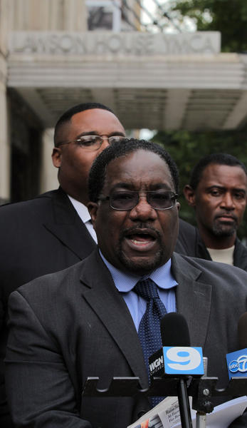 Rev. Marshall Hatch joins other activists and politicians holding a press conference on Friday, October 5, 2012, outside the Chicago headquarters of the YMCA to speak out against the planned closure of the branch in the Austin neighborhood in Chicago.