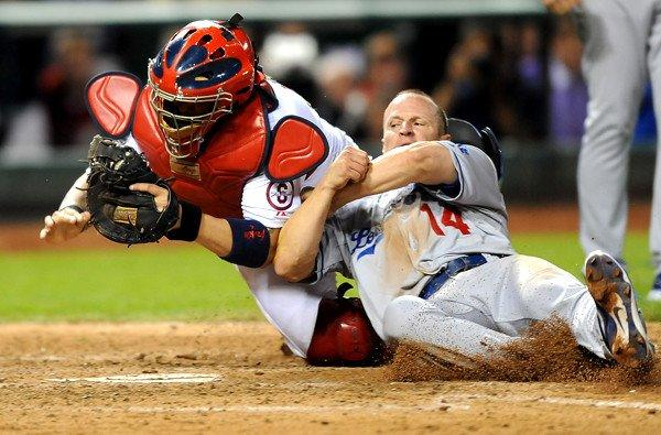 Dodgers second baseman Mark Ellis is tagged out at the plate by Cardinals catcher Yadier Molina after trying to score on a flyout by Michael Young in the 10th inning Friday night.