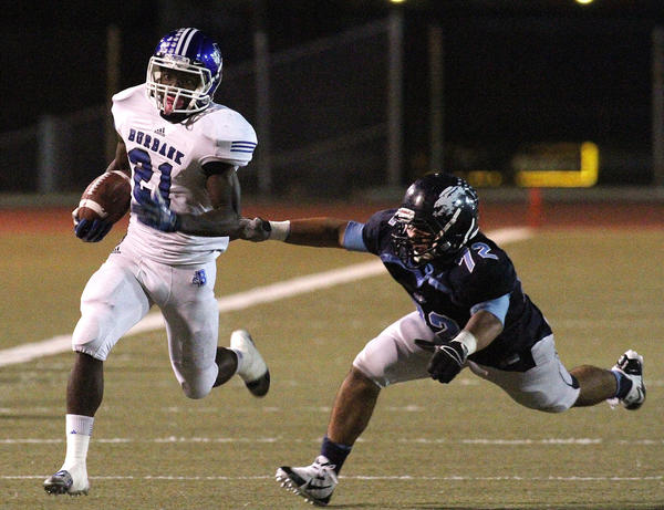 Burbank's James Williams (21) beats Crescenta Valley's Davo Hakobyan (72) to run for a touchdown in the first half in a Pacific League football game at Glendale High School on Friday, October 11, 2013.