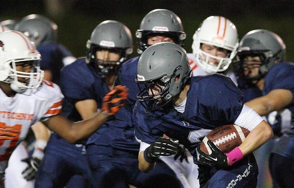 Flintridge Prep's Elliot Witter and his teammates had trouble gaining traction against Pasadena Poly in a 41-8 Prep League home defeat Friday evening at Occidental College. (Roger Wilson/Staff Photographer)