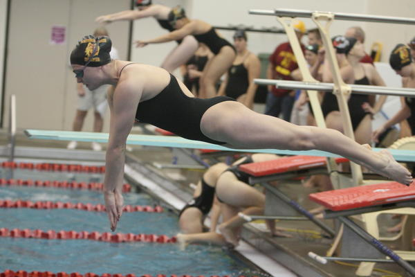 Northern States Katelyn Rhodes dives into the pool during the 400-yard medley relay on Friday during a dual against Minnesota State-Moorhead at the Aberdeen Family Y.