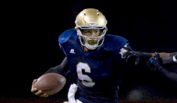 Wide receiver Koa Farmer took over at quarterback for an injured Grant Kraemer during a Sherman Oaks Notre Dame win over La Puente Bishop Amat, 31-21, on Friday.