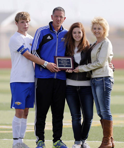 Aberdeen Central's Miah Wills, left and coach Steve Cogley, second from the left, accept the Phillip Adler Sportsmanship Award from Jessica and Lisa Adler Thursday at the State Soccer Tournament. photo by john davis taken 10/10/2013