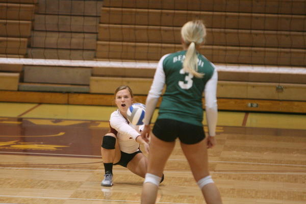 Sami Nygaard of Northern State University digs for the ball during a college volleyball match on Friday against Bemidji State. Bemidjis Courtney Volkmann is in the foreground.