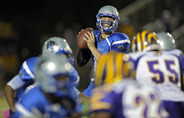 Boynton Beach quarterback Lamar Jackson looks for a receiver Grant during the first half against Boynton Beach.