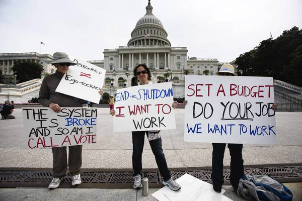 Furloughed federal employees, along with their family members, protest the government shutdown in Washington this week.