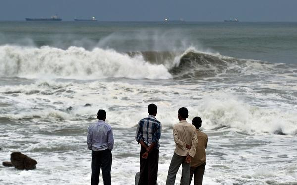 India battered by massive cyclone - Cyclone Phailin waves
