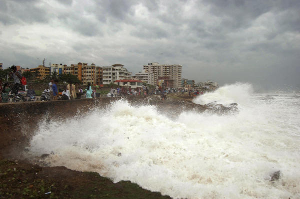 India battered by massive cyclone - Cyclone Phailin storm surges