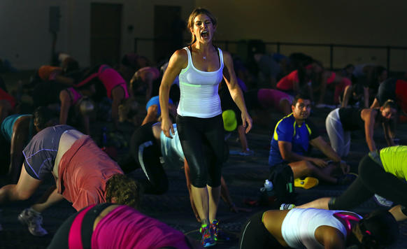 Jillian Michaels, The Biggest Loser star leads a class at the Sweat Fitness convention in Miami Beach. She's promoting her new Body Shred program.
