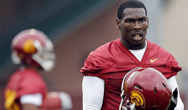 USC receiver Marqise Lee, out with a knee sprain, says he will be back for Notre Dame.