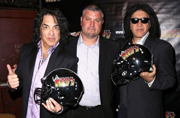 Paul Stanley, left, and Gene Simmons flank Bob McMillen, head coach of the L.A. KISS arena football team, at the House of Blues Sunset Strip in West Hollywood.