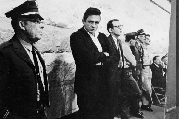 Photo of Johnny Cash and Robert Hilburn (on Cash's left) at Folsom Prison in 1968.