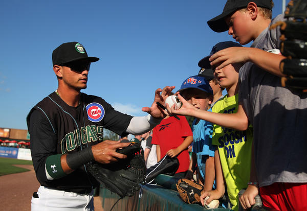 Kane County Cougars outfielder Albert Almora signs autographs for fans before a game against the Great Lakes Loons.