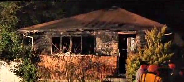Still image from video shows the house in Long Island where a woman and her three children were killed in a fire.
