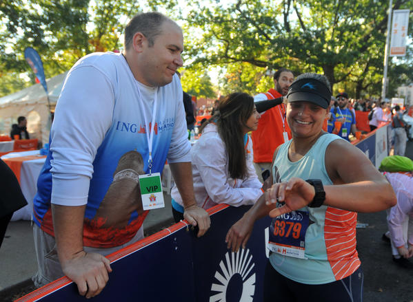 Shaun Gallagher speaks with Kelly Burns Gallagher after she completed the 20th Hartford Marathon.