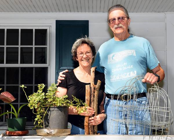 Sonja and Clint Walker use branches to make a cheap, rustic fence along their Bethlehem property.