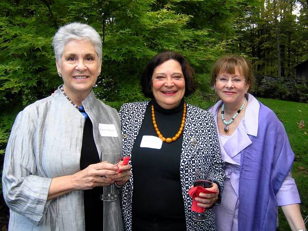 Cancer Support Community of the Greater Lehigh Valley board members Susan Mason (left), Sara George and Heather Rodale enjoy their organization's Garden of Hope party Sept. 26 at the Springtown home of Carol Dorey and John Berseth.