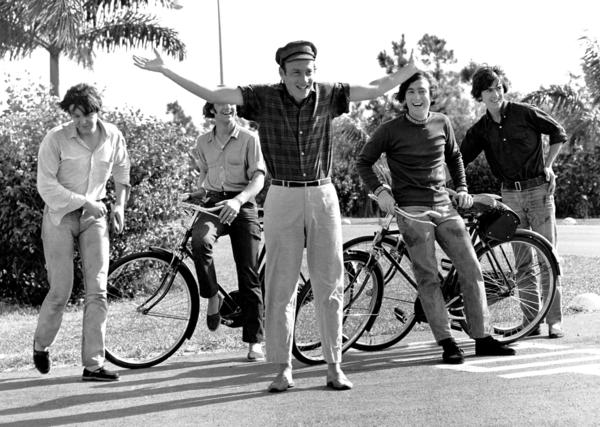 "Richard Lester, center, with the Beatles during the filming of ""Help!"" in the Bahamas."