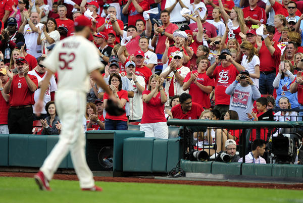 Cardinals fans cheer as starting pitcher Michael Wacha walks back to the dugout for a pitching change against the Dodgers during the 7th inning.