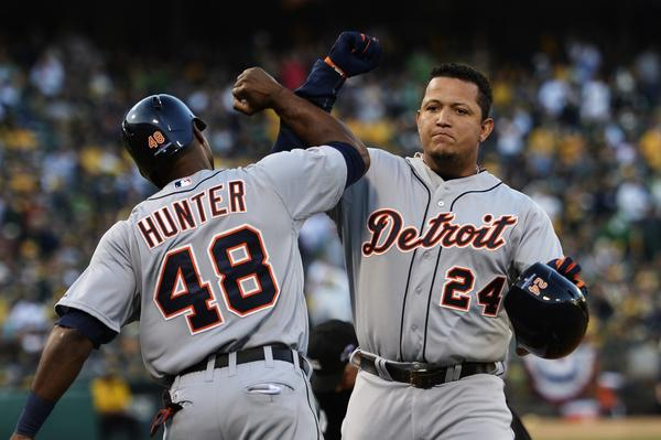 Miguel Cabrera celebrates his two-run home run with Torii Hunter against the A's.