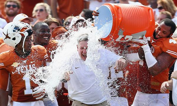 Texas Coach Mack Brown receives a celebratory ice-water shower following the Longhorns' 36-20 victory over Oklahoma on Saturday.