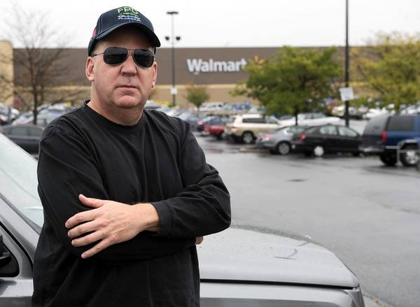 Lower Macungie resident Peter Pavlovic discuses crimes at Walmart and the need for a local police force, in front of the store in Lower Macungie on Thursday.