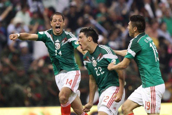 Raul Jimenez, center, from the Mexican national soccer team celebrates with teammates after scoring a goal Friday against Panama during their qualifying match in Mexico City for the 2014 World Cup games in Brazil.