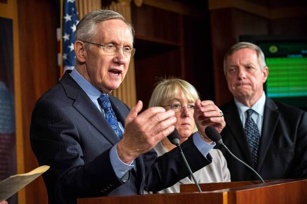 Senate Majority Leader Harry Reid, left, with Sens. Patty Murray (D-Wash.) and Richard J. Durbin (D-Ill.), met with Senate Minority Leader Mitch McConnell on Saturday to discuss the government standoff.