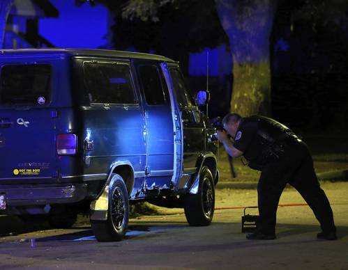 Chicago Police investigate a shooting incident at 102nd Place near State St. in Chicago overnight on Oct. 13.