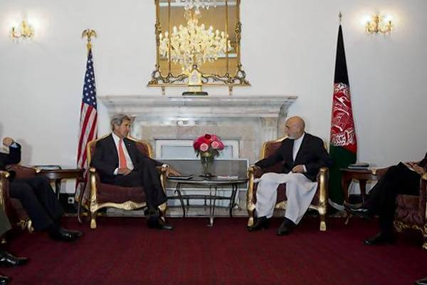 U.S. Secretary of State John Kerry meets with Afghan President Hamid Karzai, in Kabul.