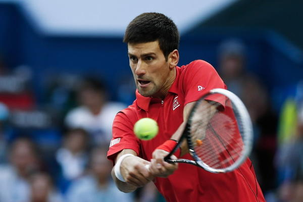 Novak Djokovic of Serbia returns a shot during final match against Juan Martin Del Potro of Argentina during the day seven of the Shanghai Rolex Masters at the Qi Zhong Tennis Center on October 13, 2013 in Shanghai, China.