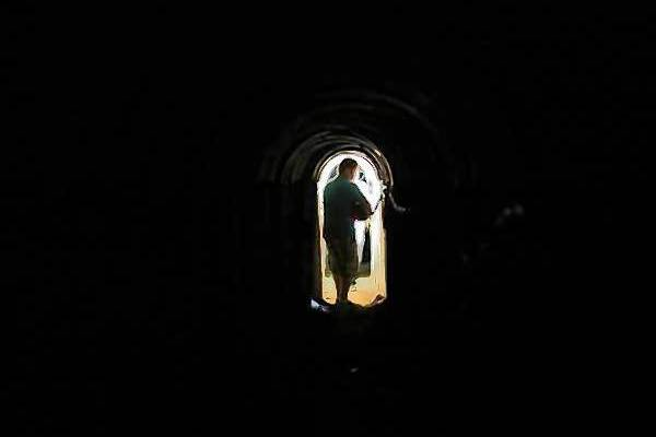 A member of the media stands inside a tunnel exposed by the Israeli military, just outside the southern Gaza Strip.